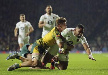 England's Joe Cokanasiga is tackled just short of the line by Australia's Michael Hooper.