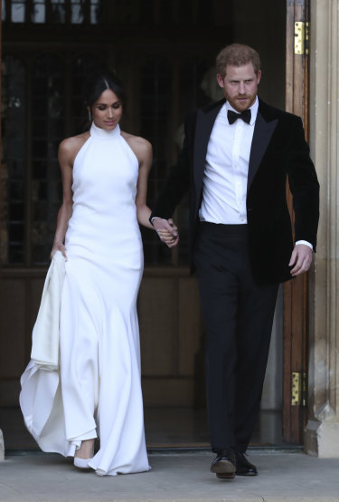 The Duke and Duchess of Sussex, in new outfits, leave their lunch reception .