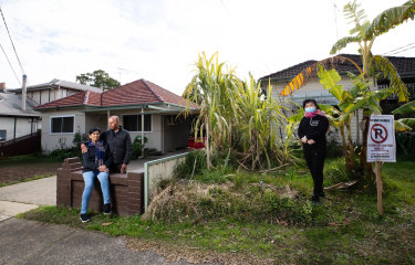 Sam and Monika Charan, with neighbour Elane He, will lose their homes to a car park as part of the federal government's Commuter Car Park Fund.