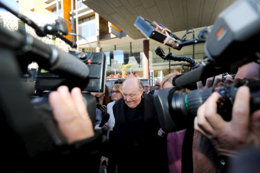 Adelaide Archbishop Philip Edward Wilson leaving Newcastle courthouse after being found guilty of concealing historical child sexual abuse.