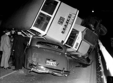 Bus overturns on a car on the Sydney Harbour Bridge, 7 August 1956.