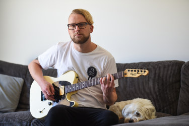 Daniel Whitehead with his dog Lemmy at home in Albury.