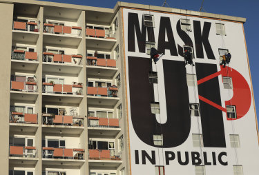 A billboard in Cape Town, South Africa, encourages the use of face masks.