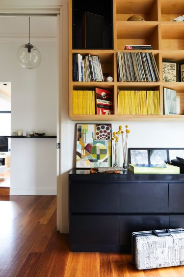 Great storage is a feature throughout. Here, the combined office and music room is lined with shelving and drawers. The vibrant abstract artwork is by Christine's childhood friend, Eliza Burke.