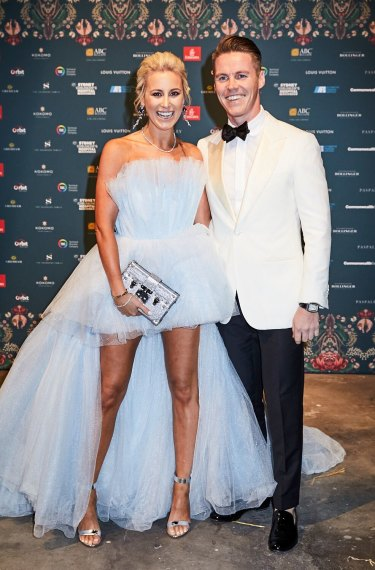 All smiles: Roxy Jacenko, wearing her famous 'mullet dress' with her husband, Oliver Curtis, at the exclusive Gold Dinner this year.