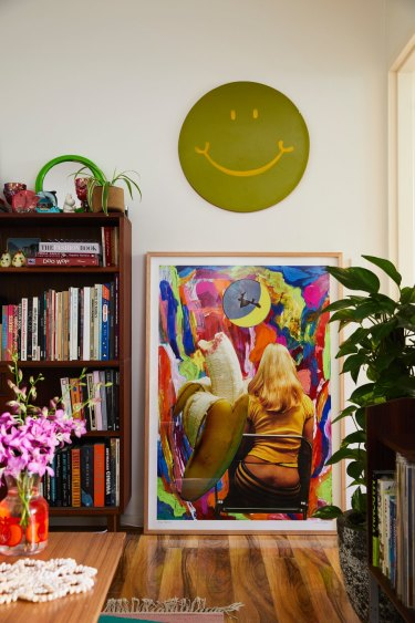 "The green smiley face is a 1970s skim board from a vintage store and hangs above one of Minna's collages. ""It works as a positive, affirming influence."""