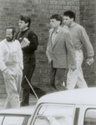 A police surveillance photo of, from second left, Graeme Jensen, Victor Peirce and Jedd Houghton at the Boronia Shopping centre in September, 1988.