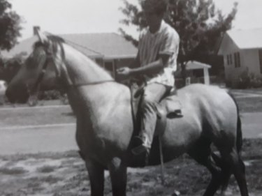 Angelo Costa rides along Warramoo Crescent, Narrabundah, in the early 1960s.
