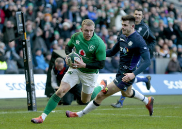 reland's Keith Earls scores their third try during the the Six Nations match.