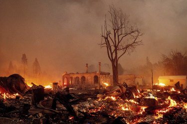 Buildings burn as the Dixie Fire this week tore through the Greenville community of Plumas County, California. The compounding events of weather extremes in a warming world will be part of the upcoming IPCC report.