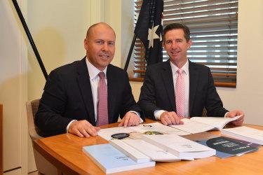 Treasurer Josh Frydenberg and Finance Minister Simon Birmingham with the budget documents.
