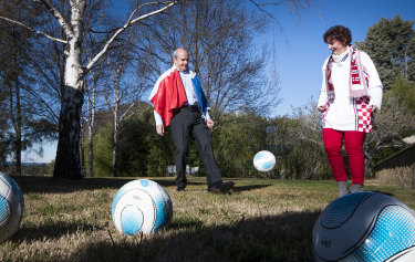 French ambassador Christophe Penot and Croatian embassy representative Sandra Tvrtkovic have a friendly kick before the World Cup final on Sunday night.