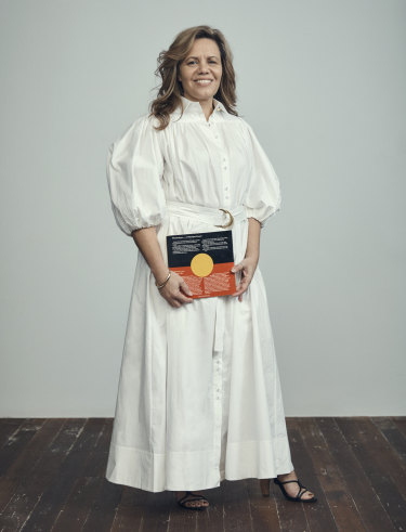 Weldon holds her Great Aunt's 1986 book 'Windradyne - A Wiradjuri Koorie' as part of a new portrait series.