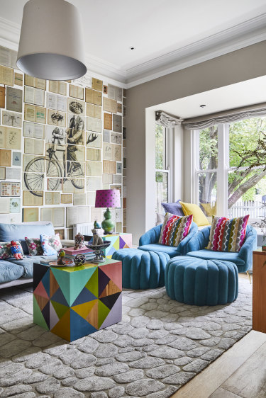 Robyn's sitting room features a mural by Russian artist Ekaterina Panikanova. The chairs are from Early Settler and the table is from Family Love Tree.