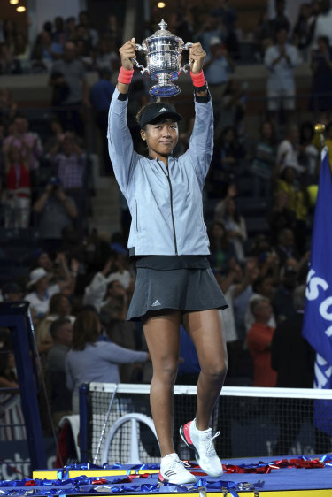 Naomi Osaka, of Japan, holds the trophy after defeating Serena Williams.