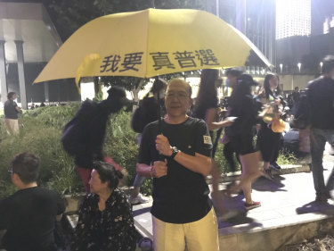 Mr Ko and his handpainted umbrella, attending a rally at Tamar Park to mark the fifth anniversary of the Umbrella Movement
