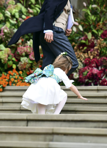Princess Charlotte trips as she makes her way into the church.