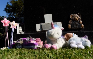 Trinkets and toys lay at the grave of baby Lily Grace who was found dead on Maroubra Beach in 2014.