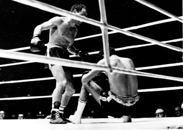 """""""First time Rocky hit the floor from a right to the jaw."""" December 2, 1965."""