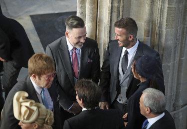 David and Victoria Beckham talk to Elton John.