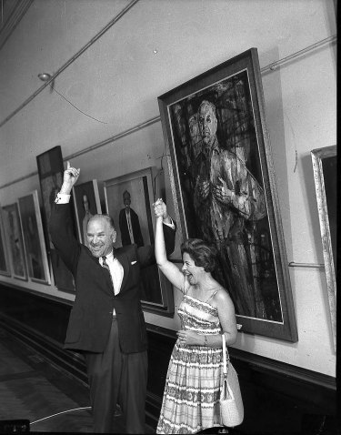 Judy Cassab is congratulated by artist Stanislaus Rapotec, when she won the 1960 Archibald Prize with a portrait of him.