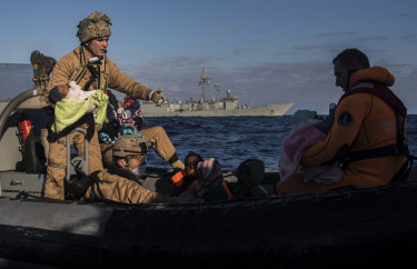 Spanish soldiers assist 329 refugees and migrants, mostly from Eritrea and Bangladesh, in collaboration with aid workers of the Spanish NGO Proactiva Open Arms, after they left Libya trying to reach European soil aboard an overcrowded wooden boat, from near Al-Khums, Libya.
