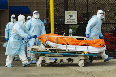 Medical workers move a body to an overflow morgue in Brooklyn, New York.