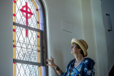 Owner Pamela Orr looks out of one of the windows in the convent's chapel, which was added as an extension to the building in 1932.