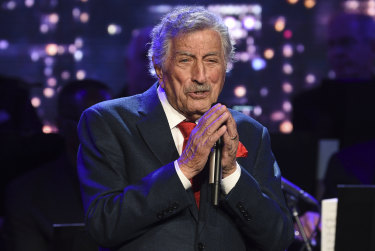 Singer Tony Bennett performs at the Statue of Liberty Museum opening celebration in New York in 2019.