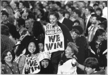 Joanne Hales with an early poster depicting Sydney's win, September 24, 1993.
