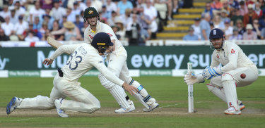 Steve Smith plays a shot watched by England's Jonny Bairstow and Jos Buttler.