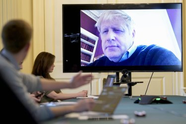 British Prime Minister Boris Johnson, pictured chairing a virtual cabinet meeting, continued to work after testing positive for coronavirus.