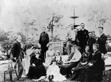 John Cameron (standing, far left) and family with friends at Doobawah, circa 1888.