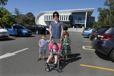 Bridget Murphy with her children Tamsin, four; Rhys, two; and Kieran, one; outside the pool in Bexley.