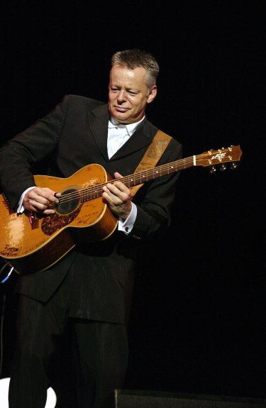 Tommy Emmanuel with his Maton guitar.
