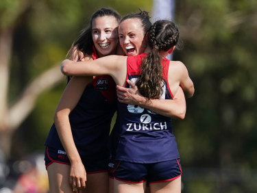 That winning feeling: Daisy Pearce and teammates.