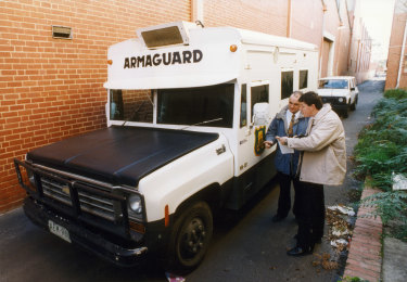 Police examine the Armaguard van after it was abandoned in the armed robbery in 1994.