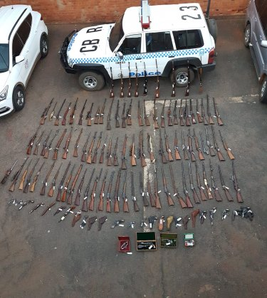More than 100 guns seized by police from a home in Cobar.