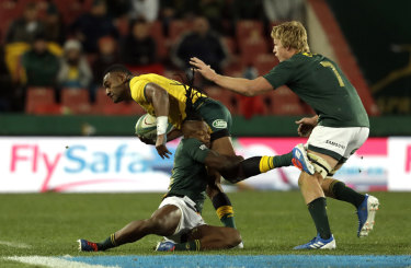 Tevita Kuridrani, left, is tackled by South Africa's S'bu Nkosi.