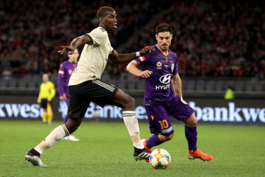 Paul Pogba of Manchester United and Bruno Fornaroli of the Glory in action.