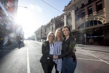 Staff members from Think Talent return to the spot on Flinders street where they were injured last year in the Flinders street attack. (L to R) Ainsley Johnstone, Cara Mullan and Natalie Firth.