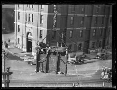 Racehorse Winooka being hoisted in a crate onto a ship on departure for America, New South Wales, 31 May 1933