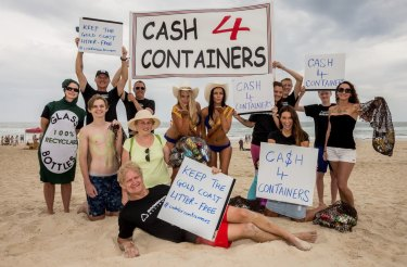 Queensland's environmental campigner Toby Hutcheon - lying on the beach - begins his campaign to recycle plastic containers from Queensland beaches.