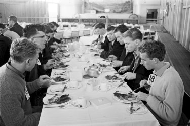 The recruits sit down to a meal.