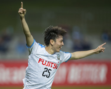 Too easy: Ao Tanaka celebrates after scoring Kawasaki Frontale's third goal on Tuesday night.