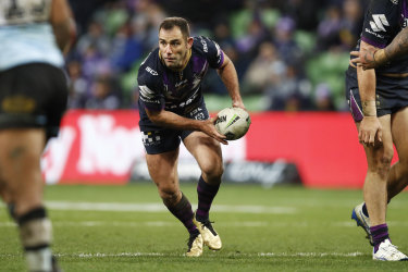 Cameron Smith of the Storm passes the ball during the Round 17 NRL match between the Melbourne Storm.