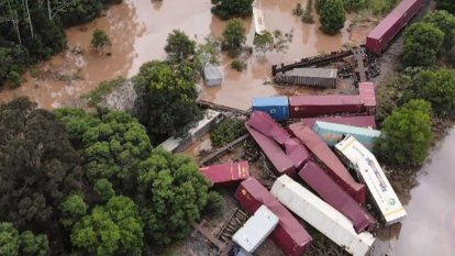 Train derails after heavy rain and floods lash NSW Mid North Coast