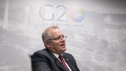 Growth on track despite 'heightened' trade war risk, says Scott Morrison from G20