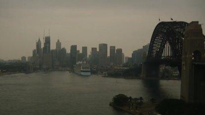 Storm rolls in over smoky Sydney