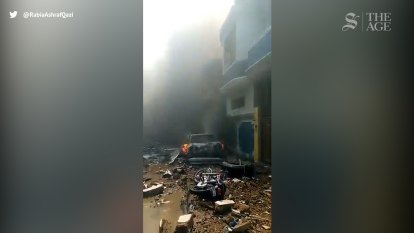 Footage moments after plane crashes in Karachi